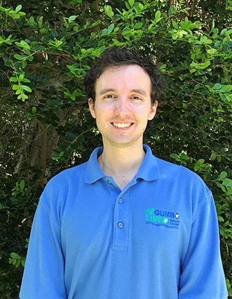 Young man wearing a blue polo shirt