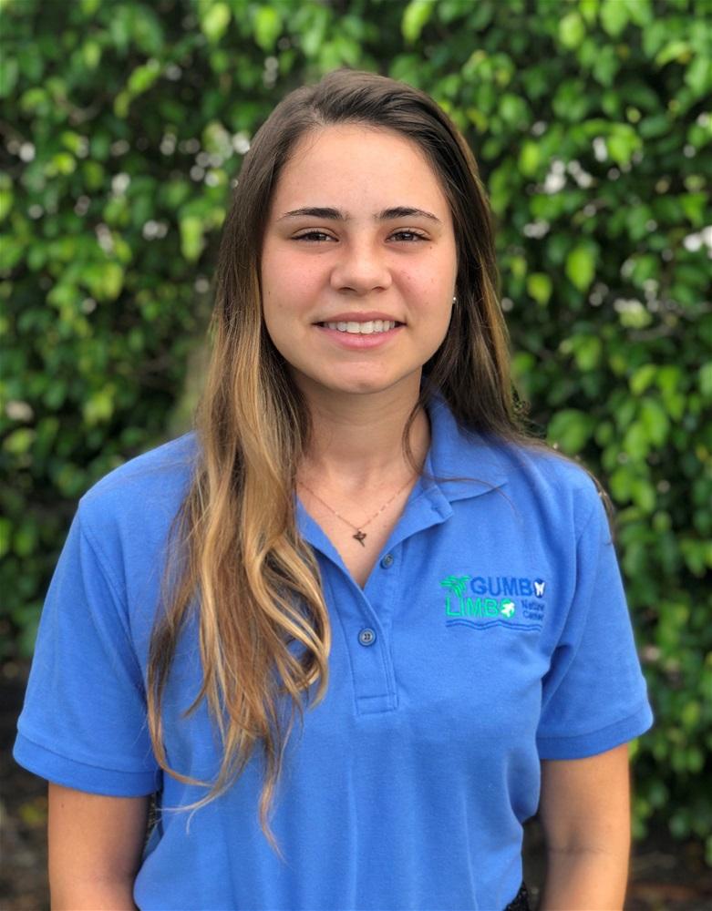 young woman wearing a blue polo shirt.